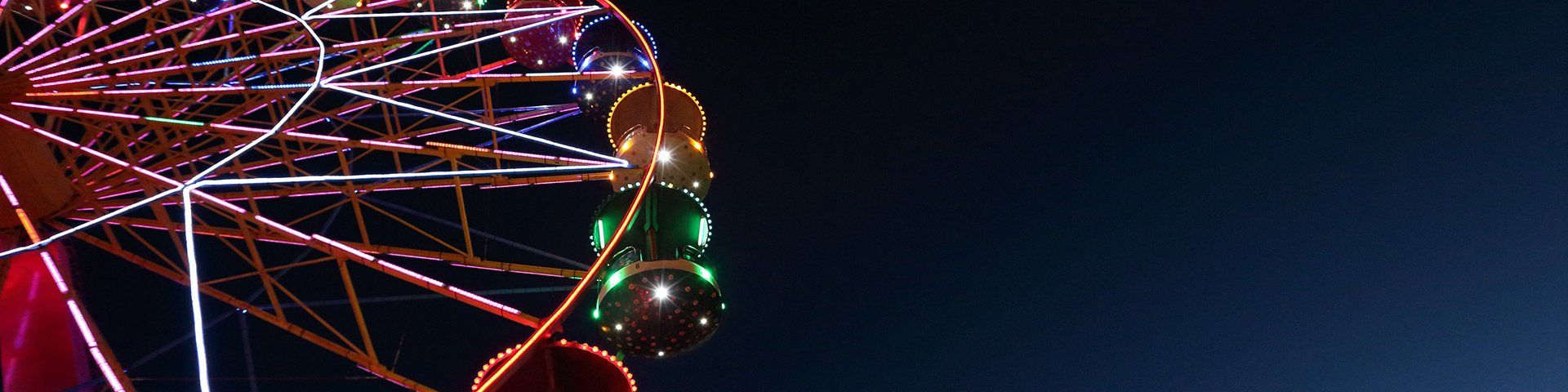 A ferris wheel illuminated against the night sky